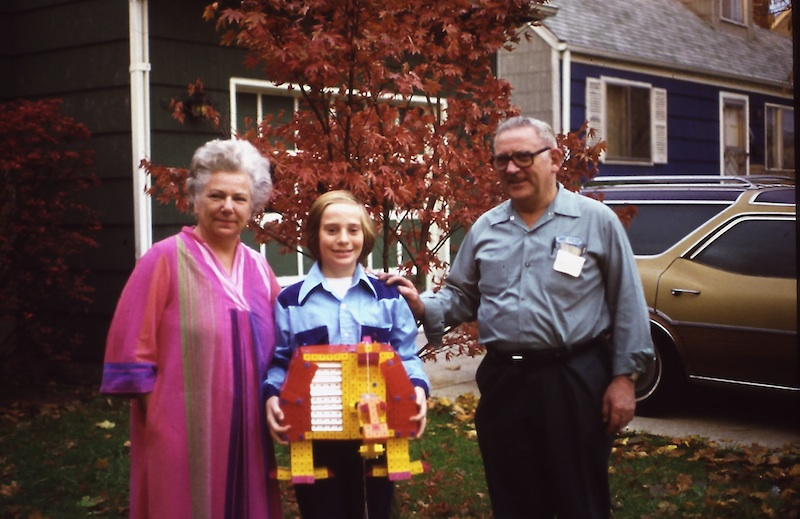 Picture of Paul Fernhout, his parents, and a robot he built from Togls toy blocks from around 1976