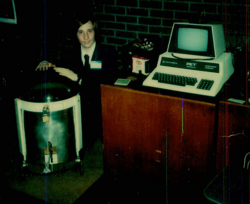 Picture of Paul Fernhout and a robot he built at the Robotic Futures Expo in 1980